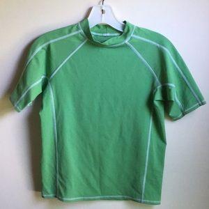 Boy's green rash guard shirt.